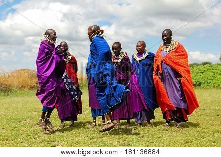 Africa Tanzania - Fеbruary 2016: Masai women in colorful clothes perform a ritual dance in a traditional village