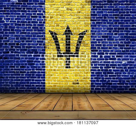 Barbados flag painted on brick wall with wooden floor