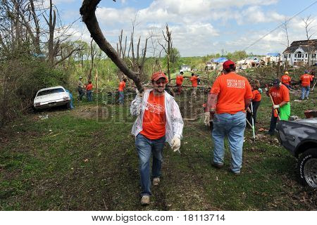 SAINT LOUIS, MISSOURI - APRIL 22:  Volunteers with Service International help residents of St. Louis with clean up efforts after tornadoes hit the Saint Louis, Missouri area on Friday, April 22, 2011.