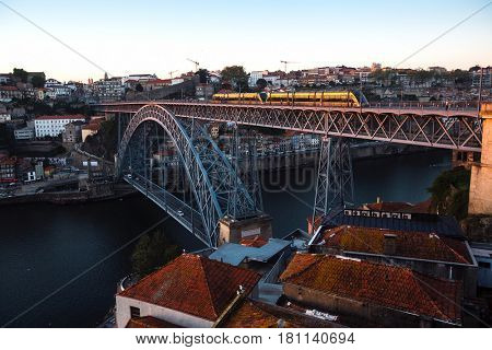 View of the Douro river and Dom Luis I Bridge at dusk, Porto, Portugal.