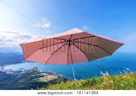 Mountain view of Taiwan coast with an umbrella