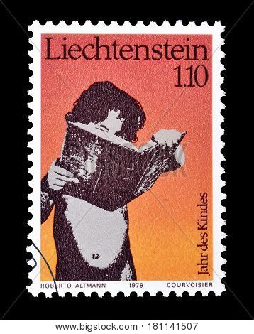 LIECHTENSTEIN - CIRCA 1979 : Cancelled postage stamp printed by Liechtenstein, that shows Child reading a book.