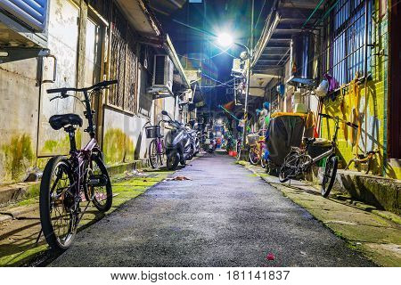TAIPEI TAIWAN - MARCH 05: This is a residential side street with old homes in the Xiangshan area of Taipei at night on March 05 2017 in Taipei