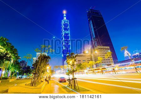 TAIPEI TAIWAN - MARCH 04: This is a view of Taipei 101 from a road in the Xinyi financial district at night on March 04 2017 in Taipei