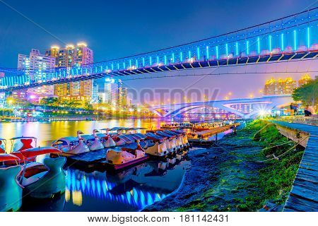 Xindian riverside bridges and architecture at night in Taipei