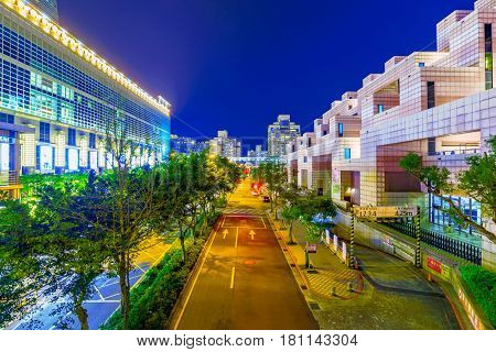 TaIPEI TAIWAN - FEBRUARY 16: This is a downtown road in Xinyi financial district with Taipei 101 mall on the left and the World trade center on the right both of which are famous landmarks on Februrary 16 2017 in Taipei
