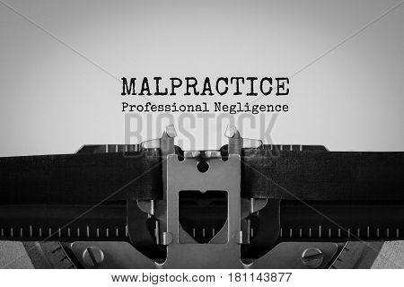 Malpractice Professional Negligence text typed on retro typewriter