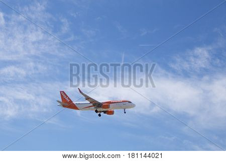 VALENCIA, SPAIN - APRIL 4, 2017: An EasyJet airliner landing at the Valenica Airport. EasyJet has a workforce of over 10,000 employees including 2,865 pilots and 6,516 cabin crew members.