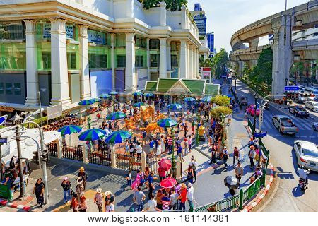 BANGKOK THAILAND - FEBRUARY 07: Outside view of Erawan shrine and downtown area of Bangkok February 07 2017 in Bangkok