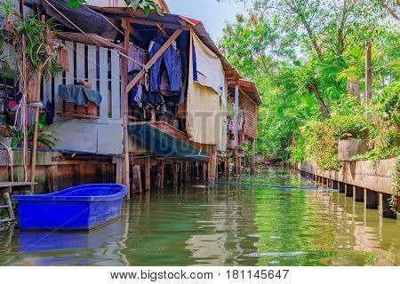 Riverside canal houses in countryside of Thailand