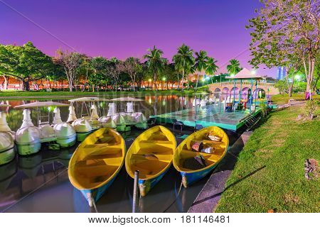 Boats in the lake in Chatuchak park at night