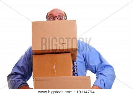Man carrying several heavy boxes.