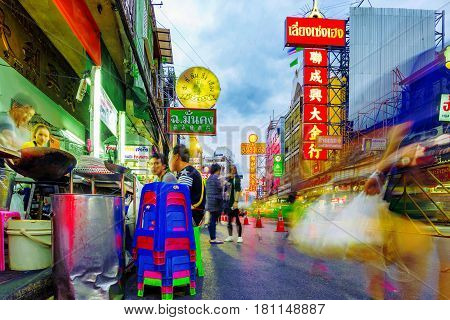 BANGKOK THAILAND - FEBRUARY 03: This a street food vendor in Chinatown Bangkok with a view of other shops and buildings on February 03 2017 in Bangkok