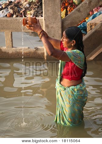 VARANASI - 6 NOVEMBER: Hindu people wash themselves in the river Ganga in the holy city of Varanasi.  The holy ritual of washing is held every day -Varanasi, India, November 6 2010