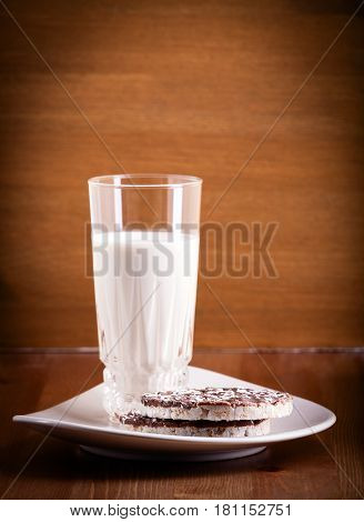 Puffed rice cookies and milk on the table