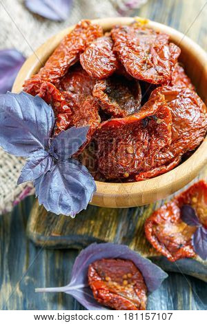 Sun-dried Tomatoes In A Wooden Bowl Closeup.