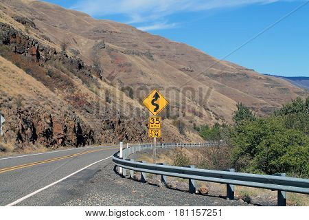 Road Sign on Curving Mountain Road in eastern Oregon USA