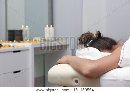 White woman on massage in spa salon
