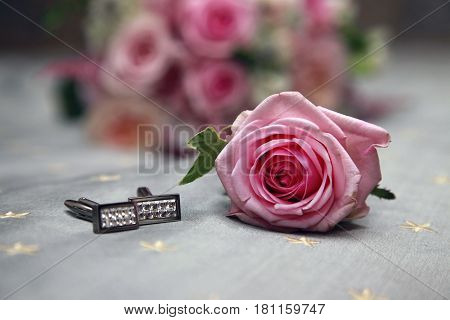 Pink rose and groom cufflinks close up