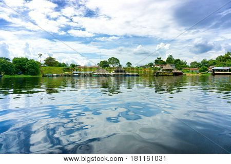Small village on the shore of the Amazon River near Iquitos Peru