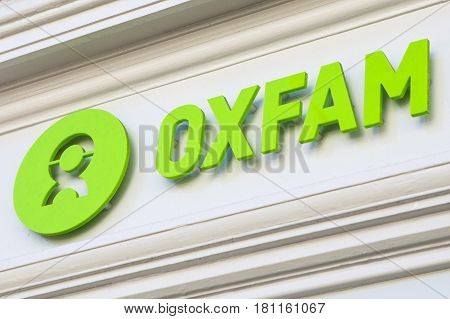 CUMBRIA UK - APRIL 4TH 2017: The Oxfam logo above a Shopfront on one of their charity shops in Cumbria UK on 4th April 2017.