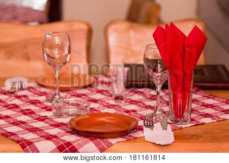 Tavern Table With Empty Glasses