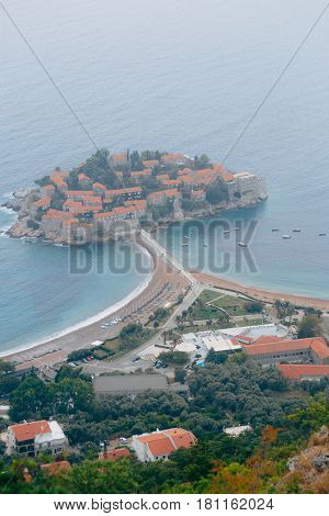 Island of Sveti Stefan, view from the church of Sveti Sava, at sunset. Montenegro, the Adriatic Sea, the Balkans. poster