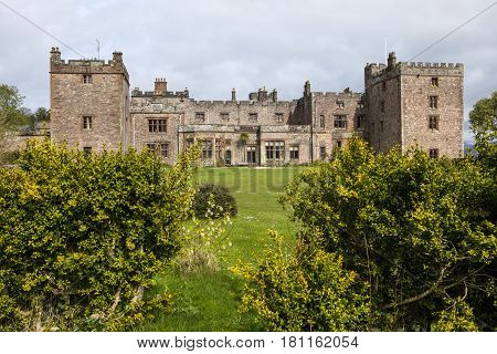 A view of Muncaster Castle in the Lake District in Cumbria UK.