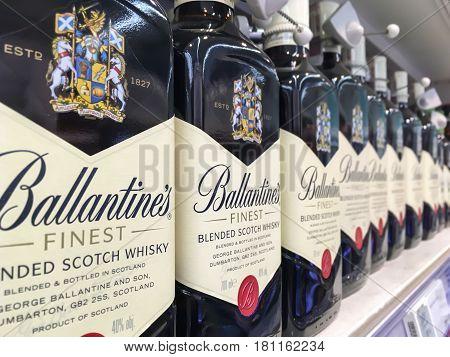 Nowy Sacz Poland - April 16 2017: Bottles of Ballantine's Finest Blended Scotch whisky on store shelves for sale in Tesco Hypermarket.