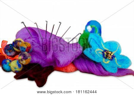Felting wool wool products flower made of wool. Isolated on white background