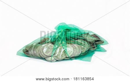 Banking package with five-ruble Russian coins on a white background