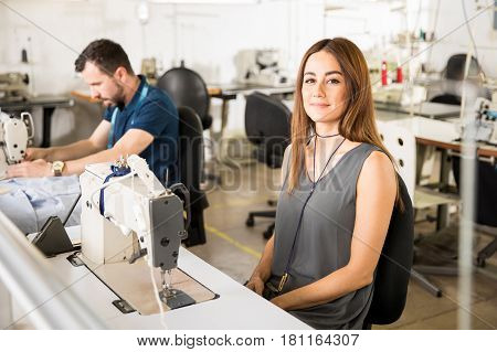 Cute Seamstress Working In A Factory