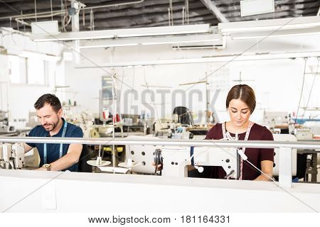 Two Tailors Working In A Factory