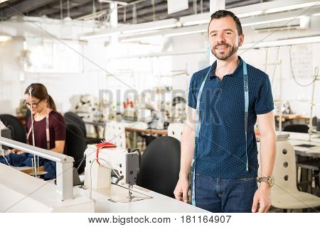 Male Tailor Working In A Factory
