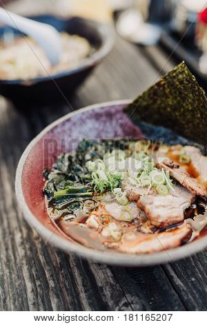 Ramen with miso based soup in a bowl on wooden table