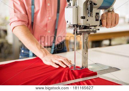 Man Using A Fabric Cutting Machine