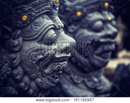 Stone sculpture on entrance door of the Temple in Bali Indonesia