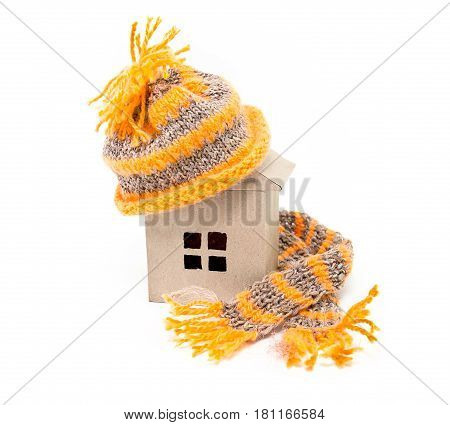 A house in a hat with a scarf. Warm house