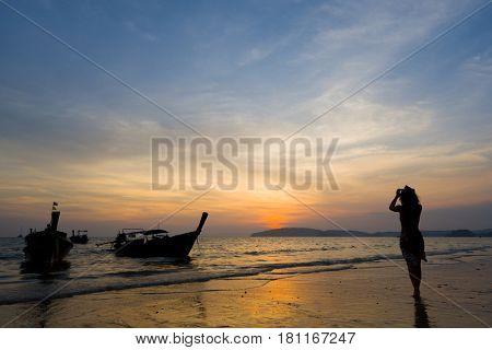 Woman on the beach in Ao Nang Krabi at sunset