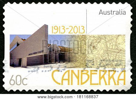 AUSTRALIA - CIRCA 2013: A used postage stamp from Australia celebrating the 100th Anniversary since the city was named Canberra crica 2013.