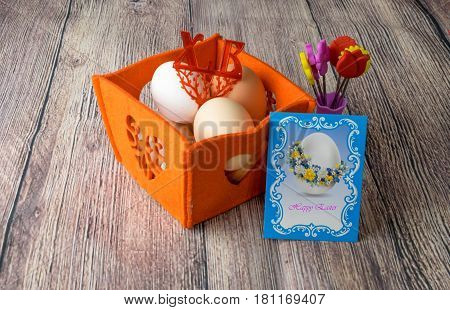 different Easter eggs table decoration with postcard