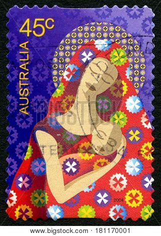 AUSTRALIA - CIRCA 2004: A used postage stamp from Australia depicting a festive illustration of Mary with baby Jesus celebrating the Christmas season circa 2004.