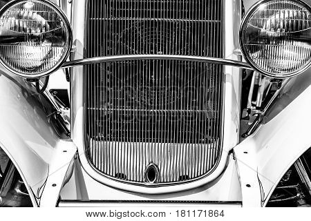 The grille and headlights of a vintage automobile.