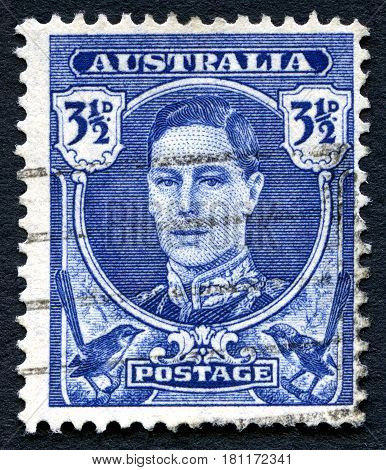 AUSTRALIA - CIRCA 1942: A used postage stamp from Australia depicting a portrait of King George VI circa 1942.