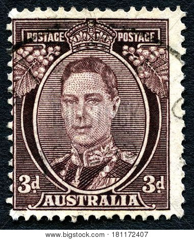 AUSTRALIA - CIRCA 1941: A used postage stamp from Australia depicting a portrait of King George VI circa 1941.
