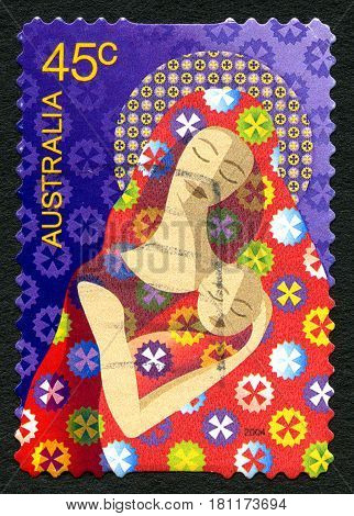 AUSTRALIA - CIRCA 2004: A used postage stamp from Australia depicting an illustration of a mother and child symbolising Mary and Baby Jesus circa 2004.