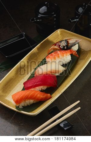 Sushi Roll With Fish In A Beautiful Blue Plate.