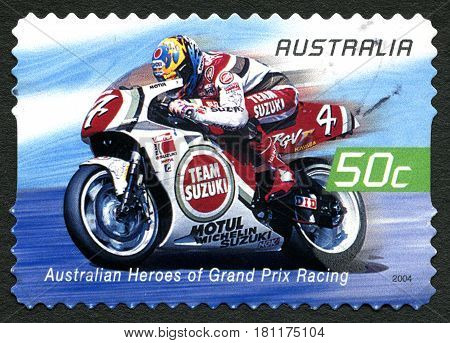 AUSTRALIA - CIRCA 2004: A used postage stamp from Australia celebrating Australian Heroes of Grand Prix Racing with an image of Daryl Beattie circa 2004.
