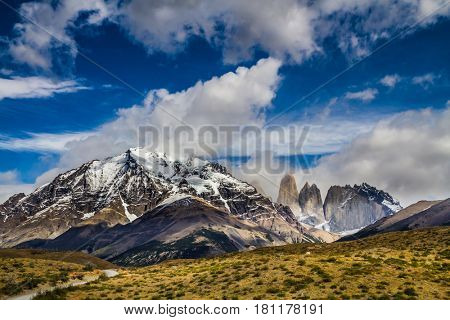 Mountains and rocks in Torres del Paine National Park. Summer in the south of Chile. The concept of car extreme tourism