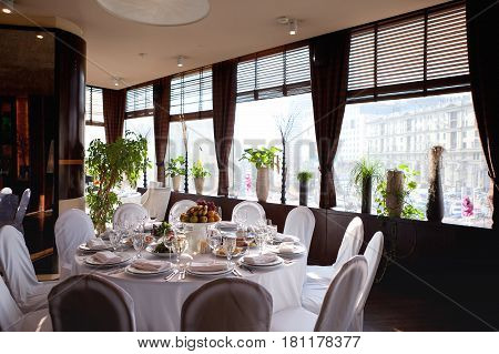 Table Setting In Restaurant. Wedding Reception Song White Table, Fruit And Glasses